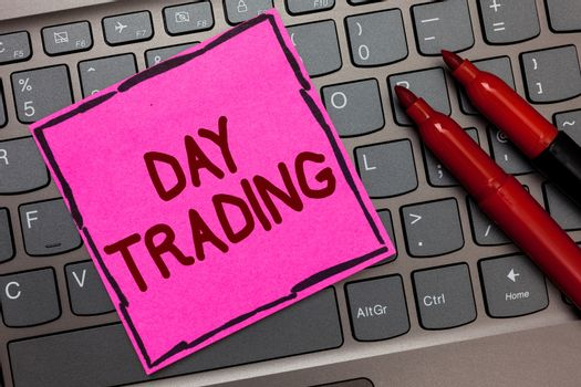 Text sign showing Day Trading. Conceptual photo securities specifically buying and selling financial instruments Pink paper keyboard Inspiration communicate ideas messages Red markers.