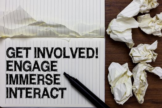 Handwriting text writing Get Involved Engage Immerse Interact. Concept meaning Join Connect Participate in the project Marker over notebook crumpled papers ripped pages several tries mistakes.