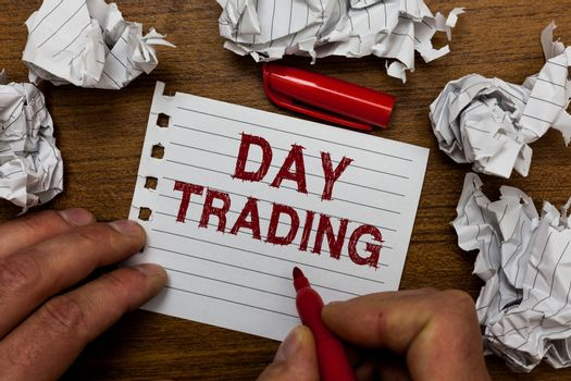 Writing note showing Day Trading. Business photo showcasing securities specifically buying and selling financial instruments Man holding marker notebook page crumpled paper several tries mistakes.