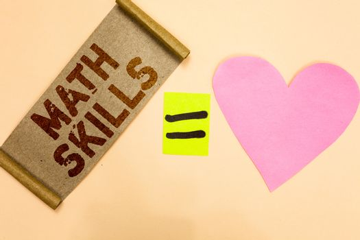 Writing note showing Math Skills. Business photo showcasing starting to learn how to count numbers add divide use equation Piece fabric reminder equal sign pink heart sending romantic message