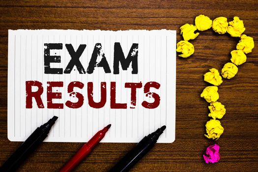 Handwriting text writing Exam Results. Concept meaning An outcome of a formal test that shows knowledge or ability Paper markers crumpled papers forming question mark wooden background