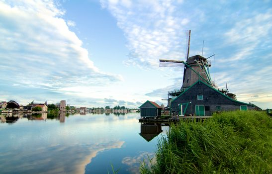 Zaanse Schans Windmill De Kat from River Coast with Reflection of Sky Early Morning Outdoors