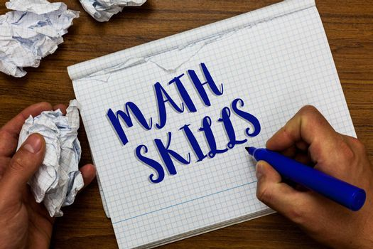 Conceptual hand writing showing Math Skills. Business photo showcasing starting to learn how to count numbers add divide use equation Man holding marker notebook crumpled papers ripped pages