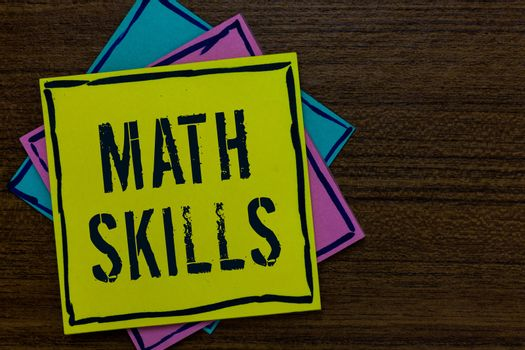 Conceptual hand writing showing Math Skills. Business photo text starting to learn how to count numbers add divide use equation Paper notes Important reminders Express messages Wooden background