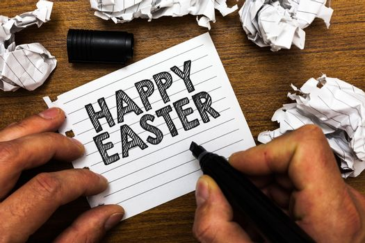 Text sign showing Happy Easter. Conceptual photo Christian feast commemorating the resurrection of Jesus Man holding marker notebook page crumpled papers several tries mistakes