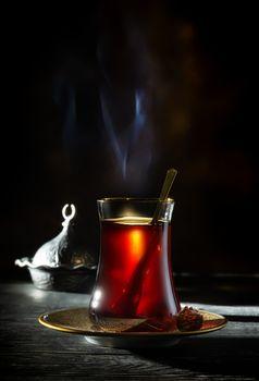 Turkish tea on black background