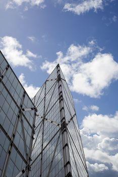 london city centre skyscraper against a blue cloudy sky
