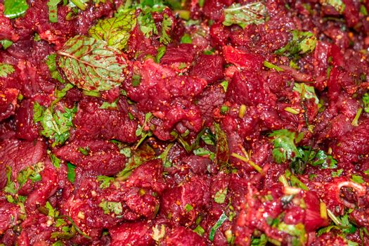 Raw spicy Thai minced beef salad, Northeast Thailand food culture. Cause of tapeworm. Unclean food. Unhygienic food culture