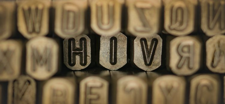 HIV spelled from metal stamp alphabet punch, HIV words stand for The Human Immunodeficiency Virus