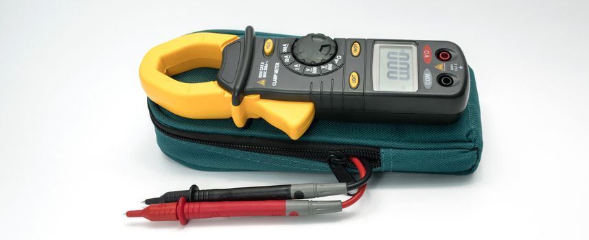 Digital clamp meter with probes on white background