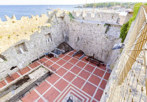 The interior of the Frankopan Castle, at Kamplin square in Krk, Croatia - Frankopanski Kastel, part of the medieval city walls. View of the courtroom, ancient excavations, catapult and sea port of the island.