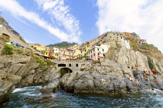 Manarola town, Riomaggiore, La Spezia province, Liguria, northern Italy. View of the colourful houses on surrounding hills, sea shore, balconies and windows. Part of the Cinque Terre National Park and a UNESCO World Heritage Site.