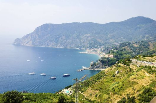 Aerial view of Monterosso Al Mare village, La Spezia province, Liguria, northern Italy. Panoramic view of the sandy colorful beach gulf, and the mountain hills. Part of the Cinque Terre National Park and a UNESCO World Heritage Site.