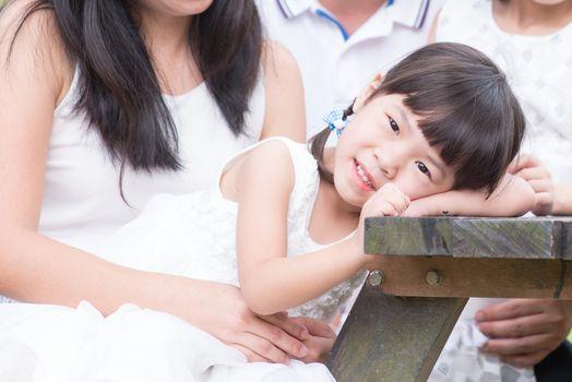 Happy Asian family bonding at outdoor