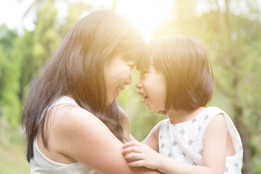 Mother and daughter bonding outdoors.