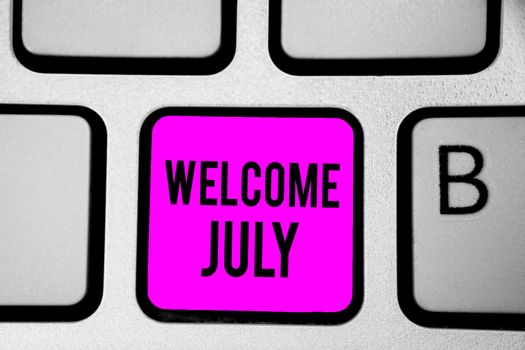Conceptual hand writing showing Welcome July. Business photo text Calendar Seventh Month 31days Third Quarter New Season Keyboard purple key Intention create computer reflection document