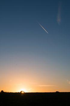Sunrise and Plane Trail