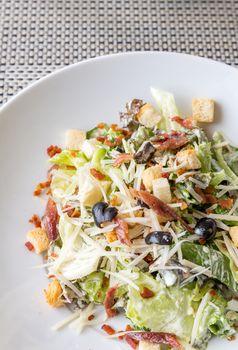 Caesar salad with bacon and chicken, mediterranean cuisine