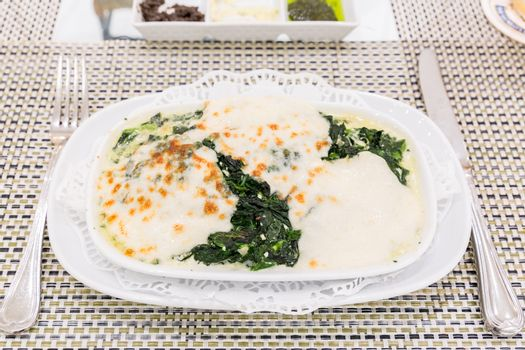 Baked spinach with cheese, Italian cuisine