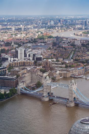Aerial view of London Tower Bridge and Skyscraper in Canary Whraf, London UK.