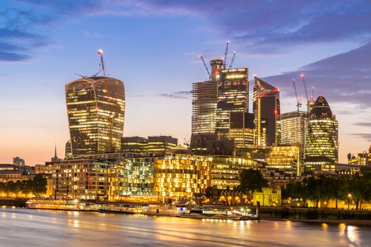 London downtown cityscape skylines building with River Thames at sunset dusk in London UK