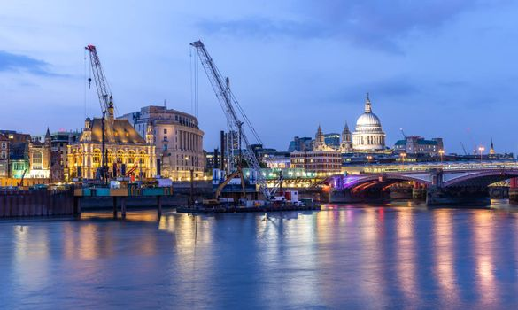 Panoramic of St paul cathedral with river thames sunset twilight in London UK.