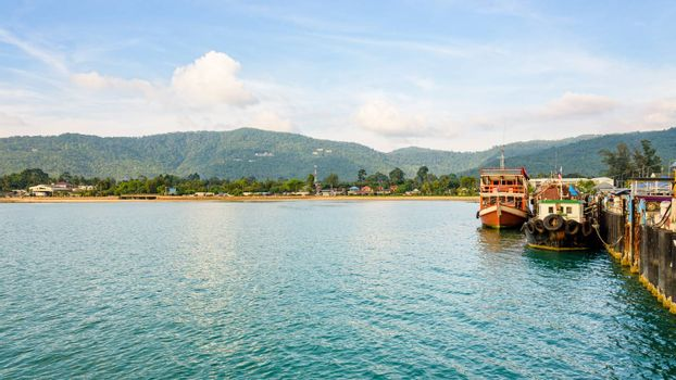 Wooden boat for dive tour docked at Nathon Pier near Nathon Beach with a peaceful sea atmosphere in the evening at Koh Samui island, Surat Thani province, Thailand, 16:9 widescreen