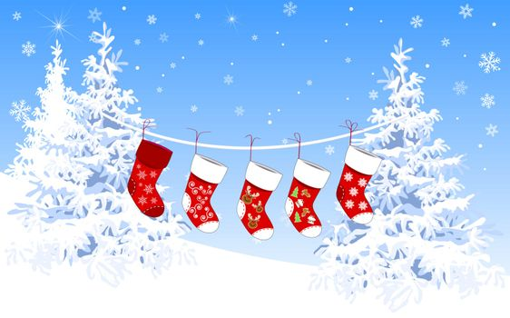 Christmas socks for gifts on a winter background, against a background of snow-covered fir trees.