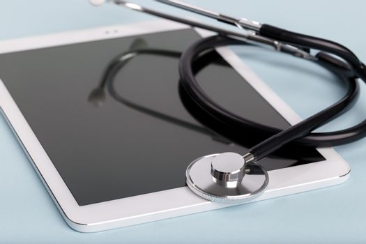 Black stethoscope and tablet