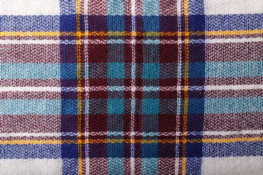Colorful autumn checkered knitted fabric texture background close up macro