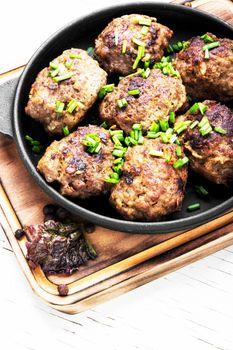 Meatballs in cast iron skillet
