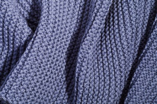 Blue wool knitted scarf.
