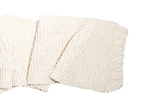 Knitted wool white scarf isolated.