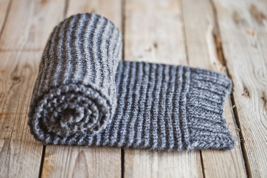 Hand knitted gray scarf.
