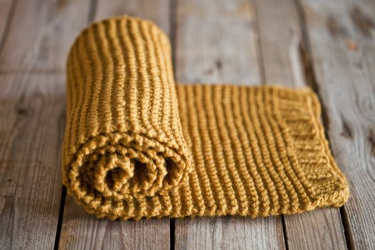 Hand knitted yellow scarf.