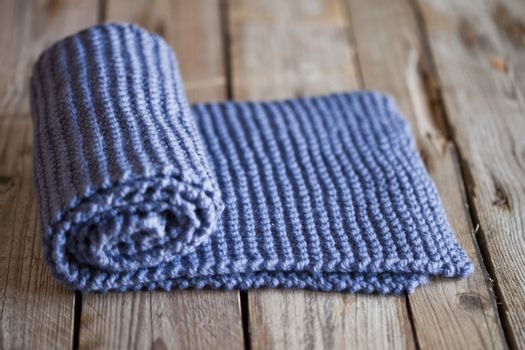 Hand knitted blue scarf.