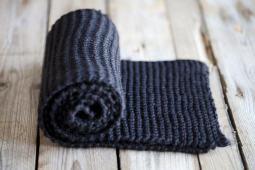 Hand knitted black scarf.