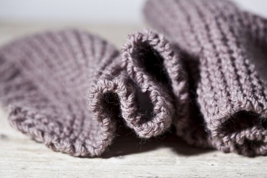 Knitted brown scarf.