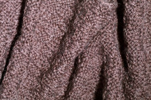Knitted brown scarf texture.