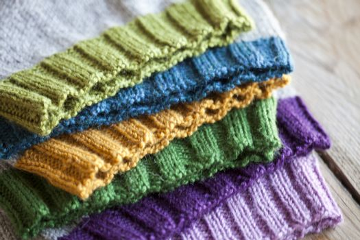 Multicolor knitted hats stack.