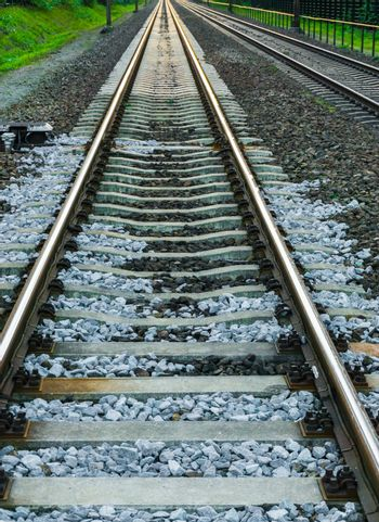 Long train railroad track in closeup transportation and travel background