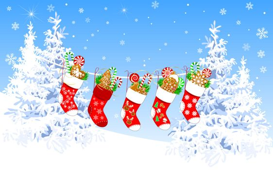 Christmas socks with sweets on a winter background, against a background of snow-covered fir trees and the sky with snowflakes.