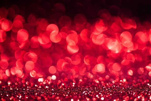 Abstract shining glitters red holiday bokeh background with copy space for text