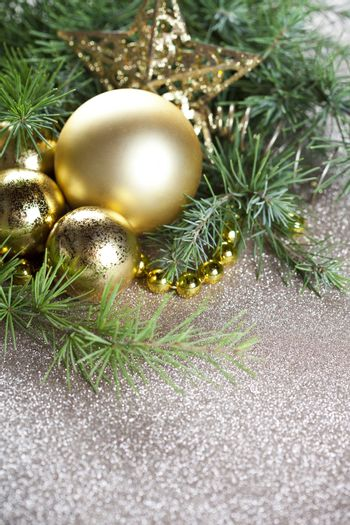 Christmas decorations and evergreen fir tree branch.