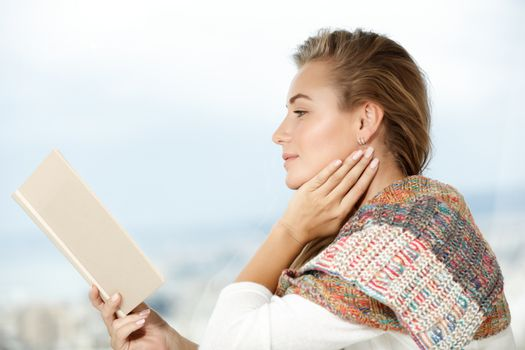 Calm female reading book