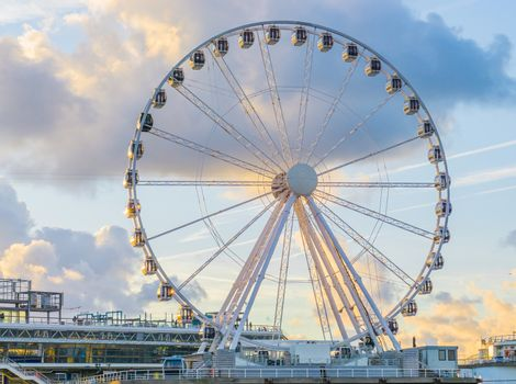 big ferris wheel attraction at the pier of Scheveningen beach Holland a well-known and touristic town