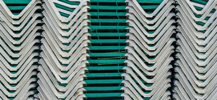 pattern of deckchairs stacked on a pile summer season beach holiday background