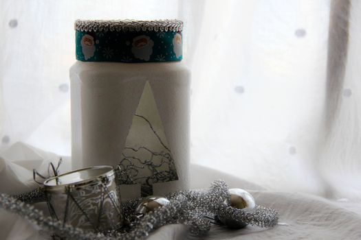 christmas background with handmade lamp with toys. photo