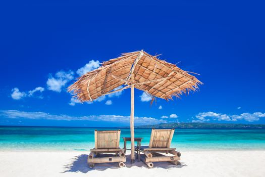 Lounge chairs under tent on beach
