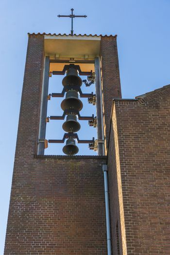 group of ringing church bells hanging in a church tower